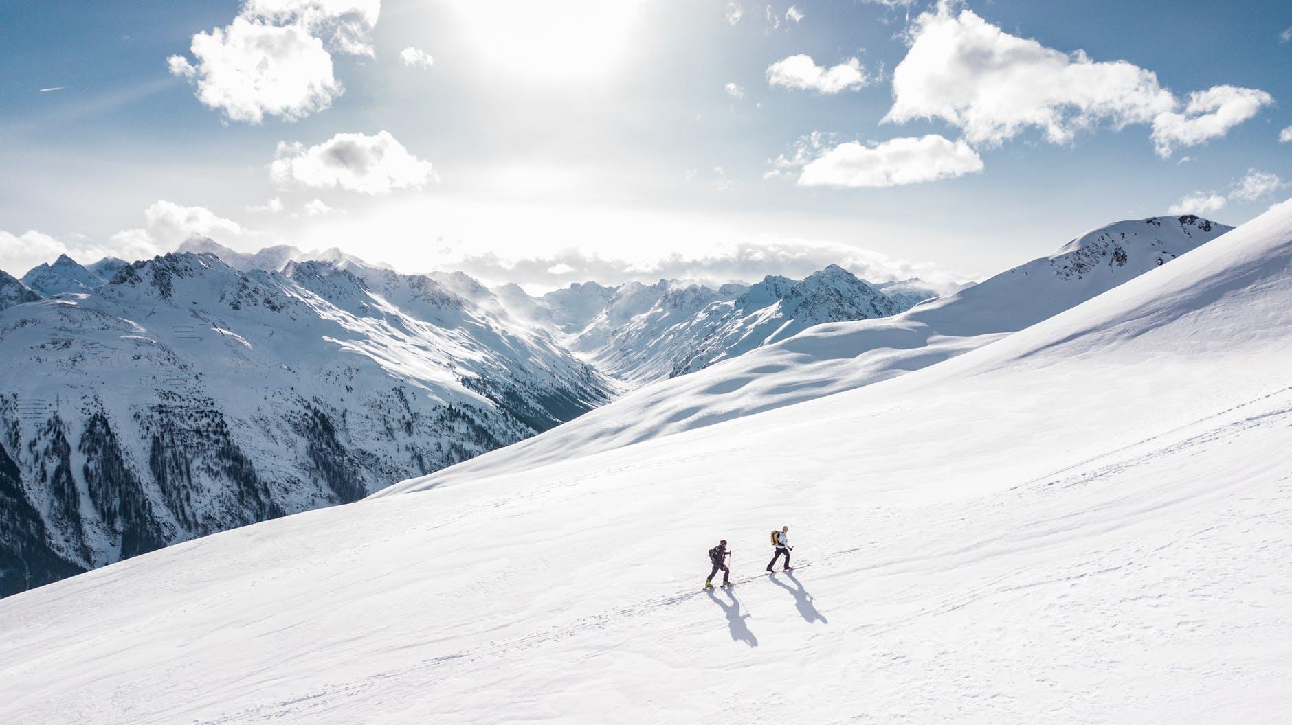 two man hiking on snow mountain