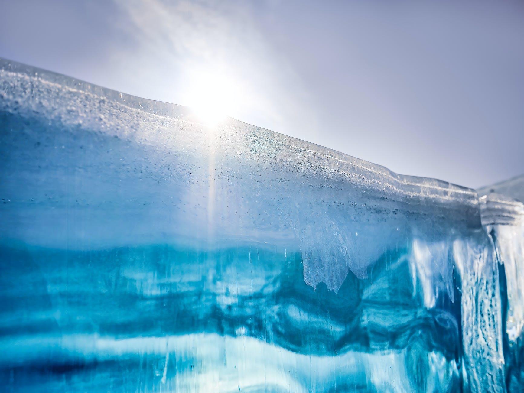 a blue glacier under the sun