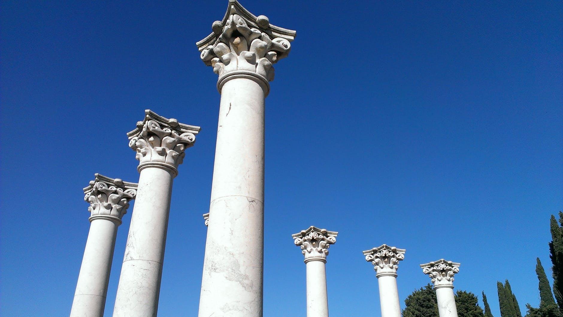classic stone columns on blue sky