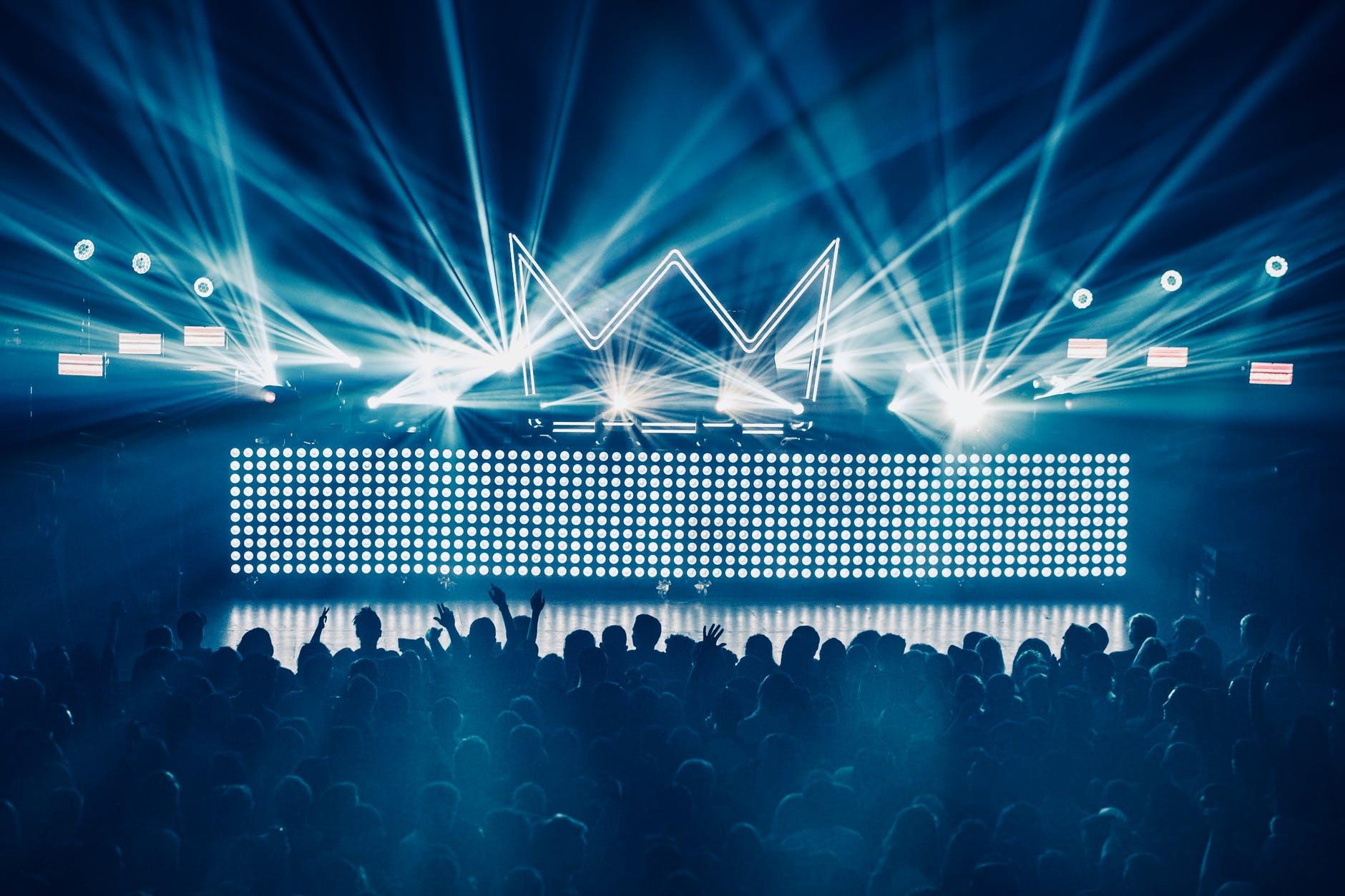 silhouette of dancing people inside club