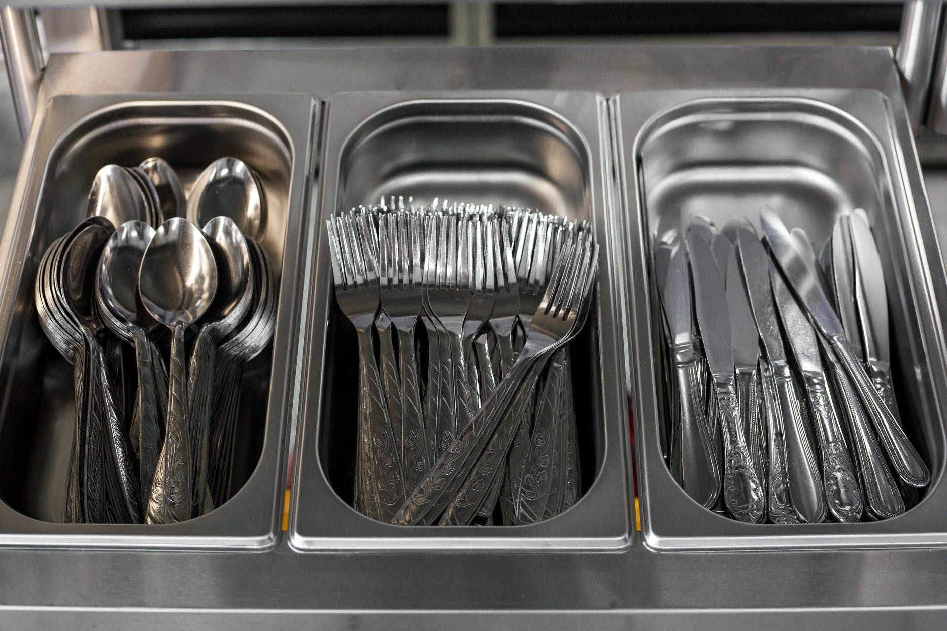 set of kitchen utensils in metal containers